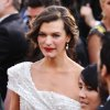 Milla Jovovich arrives before the 84th Academy Awards on Sunday, Feb. 26, 2012, in the Hollywood section of Los Angeles. (AP Photo/Joel Ryan) ORG XMIT: OSC153