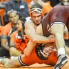 At 165 pounds, Oklahoma\'s Bubby Graham won by a decision over Oklahoma State\'s Dallas Bailey by a final tally of 6-2. KT King/For the Tulsa World