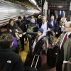 Passengers rush to board a train in New York\'s Penn Station, Friday, Feb. 8, 2013. A storm poised to dump up to 3 feet of snow from New York City to Boston and beyond beginning Friday could be one for the record books, forecasters warned, as residents scurried to stock up on food and water and road crews readied salt and sand. Amtrak rail said its Northeast trains will stop running Friday afternoon. (AP Photo/Mark Lennihan) ORG XMIT: NYML103