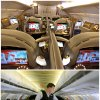 This combination of Associated Press file photos show, on top, the first class section of an Emirates airlines Airbus A380 at the new Concourse A of Dubai airport in Dubai, United Arab Emirates in 2013, and on the bottom, Allegiant Air flight attendant Chris Killian preparing his passengers for the Laredo, Tex, bound flight before it pushes back from the terminal at McCarran International Airport in Las Vegas, in 2013. When Emirates Airline opened a new concourse at its home airport in Dubai last year, it made sure to keep coach passengers separate from those in business and first class. The top floor of the building is a lounge for premium passengers with direct boarding to the upstairs of Emirates' fleet of double-decker Airbus A380s. Those in coach wait one story below and board to the lower level or the plane. (AP Photo/File)
