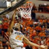 Oklahoma State\'s Markel Brown (22) dunks the ball during a men\'s college basketball game between Oklahoma State University (OSU) and Gonzaga at Gallagher-Iba Arena in Stillwater, Okla., Monday, Dec. 31, 2012. Photo by Nate Billings, The Oklahoman