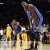 Oklahoma City\'s Kevin Durant (35) and Russell Westbrook (0) rest their hands on their knees late in the fourth quarter during Game 3 in the second round of the NBA basketball playoffs between the L.A. Lakers and the Oklahoma City Thunder at the Staples Center in Los Angeles, Friday, May 18, 2012. Photo by Nate Billings, The Oklahoman
