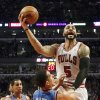Chicago Bulls forward Carlos Boozer (5) shoots over Oklahoma City Thunder guard Kevin Martin (23) as Thabo Sefolosha (2) watches during the first half of an NBA basketball game, Thursday, Nov. 8, 2012, in Chicago. (AP Photo/Charles Rex Arbogast) ORG XMIT: CXA109