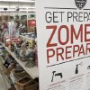 "Photo -  A sign promoting zombie preparadness is seen in a hardware store in Omaha, Neb., Monday, Oct. 10, 2011. The Westlake Ace hardware chain with stores in seven states is offering tips on how to ""zombie-proof"" your house. The store is advertising nail guns and chain saws for ""zombie defense,"" and one part of a Q-and-A section asks: ""A zombie fell and put a hole in my drywall. What tools will I need to fix this?""(AP Photo/Nati Harnik)"