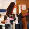 Children cheered and laughed and rushed to touch this 7 foot-tall turkey as he walked through the halls of Herronville Elementary School at SW 29 and McKinley Tuesday morning, Nov. 22, 2011. Inside the turkey suit was Leon Hill, a veteran educator who is serving his first year as principal at this south Oklahoma City Public School. Last month, Hill issued a reading challenge to his students, which range from pre-kindergarten through fifth grade. He promised that if they would read at least 3,000 books, he would come to school dressed as a turkey before the Thanksgiving break. The students accepted the challenge and exceeded their goal, reading a total of 4,444 books. Hill credited the success of the reading challenge to the school\'s teachers and to the parents who either read with their children or encouraged them to read. Photo by Jim Beckel, The Oklahoman