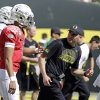 FILE - In this April 7, 2013, file photo, Oregon coach Mark Helfrich, right, looks back at quarterback Marcus Mariota as they run onto the field for their spring NCAA college football game in Eugene, Ore. The NCAA\'s Division I Committee on Infractions will release a public report on the findings of its investigation and any possible sanctions against Oregon\'s football program on Wednesday morning, June 26, 2013. (AP Photo/Don Ryan, File) ORG XMIT: NY169