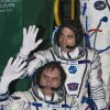 Photo - Russian Cosmonaut Pavel Vinogradov, bottom, and U.S. astronaut Christopher Cassidy, crew members of the mission to the International Space Station (ISS), wave prior to the launch of Soyuz-FG rocket at the Russian leased Baikonur Cosmodrome, Kazakhstan, Thursday, March 28, 2013. (AP Photo/ Shamil Zhumatov, Pool)