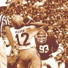 An OU legend: Defensive lineman Lee Roy Selmon gets the nod as the best Sooner football player of all-time. Selmon going after Iowa State quarterback Tom Mason. Staff Photo by J. Pat Carter (Original photo taken 10/25/75, ran 12/03/75 TIMES)