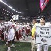 Oklahoma\'s Kenny Stills looks for his mom in the stands as he holds a championship poster after 23-20 win over Nebraska during the Big 12 football championship game between the University of Oklahoma Sooners (OU) and the University of Nebraska Cornhuskers (NU) at Cowboys Stadium on Saturday, Dec. 4, 2010, in Arlington, Texas. Photo by Chris Landsberger, The Oklahoman