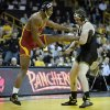 Iowa\'s Bobby Telford, right, tries to take down Iowa State\'s Matt Gibson during their 285 lbs. match in an NCAA college wrestling meet on Saturday, Dec. 1, 2012, in Iowa City, Iowa. (AP Photo/Charlie Neibergall)