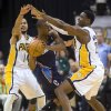 Kemba Walker (15) drives against Indiana Pacers\' D.J. Augustin (14), left, and Ian Mahinmi (28) during the second half of an NBA basketball game in Indianapolis, Saturday, Jan. 12, 2013. The Pacers defeated the Bobcats 96-88. (AP Photo/Doug McSchooler)