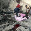 EDS NOTE: GRAPHIC CONTENT - People evacuate a casualty from the scene of a car bombing in Basra, 340 miles (550 kilometers) southeast of Baghdad, Iraq, Sunday, July 14, 2013. A wave of explosions tore through overwhelmingly Shiite cities south of Baghdad shortly before the Muslim faithful broke their Ramadan fasts, killing tens of people and wounding dozens, according to officials. The bombings are part of a sudden surge of violence that has brought Iraq to the brink of all-out sectarian conflict. (AP Photo/ Nabil al-Jurani)