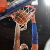 Photo - New York Knicks' Tyson Chandler dunks the ball during the second quarter of an NBA basketball game against the Cleveland Cavaliers Thursday, Jan. 30, 2014, at Madison Square Garden in New York. (AP Photo/Bill Kostroun)