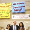 Photo -  Robert Neu, center, new Oklahoma City Public School superintendent, poses with seniors Ana Cardenas and Eliza Barrientos on Thursday below a sign welcoming him to U.S. Grant High School in Oklahoma City. Photo by Paul B. Southerland, The Oklahoman   PAUL B. SOUTHERLAND -  PAUL B. SOUTHERLAND