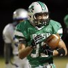 Danny Krenger (33) of Bishop McGuinness breaks away for a second-quarter touchdown during a high school football game between Bishop McGuinness and Guthrie at Bishop McGuinness Catholic High School in Oklahoma City, Friday, Oct. 26, 2012. Photo by Nate Billings, The Oklahoman