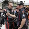 Photo - Kurt Busch, left, is congratulated by a member of his crew after he qualified for the second time on the first day of qualifications for Indianapolis 500 IndyCar auto race at the Indianapolis Motor Speedway in Indianapolis, Saturday, May 17, 2014. (AP Photo/AJ Mast)
