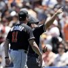 Photo - Miami Marlins manager Mike Redmond is tossed out of the game after arguing a call during the fifth inning of a baseball game against the San Francisco Giants on Saturday, June 22, 2013, in San Francisco. (AP Photo/Marcio Jose Sanchez)