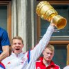 Photo - Bayern Munich's   goalie Manuel Neuer  celebrates the club's  Cup title with teammates on the balcony of the city hall in Munich, Germany,  Sunday May 18, 2014. Munich won the final of the German soccer Cup  against Borussia Dortmund  on Saturday. (AP Photo/dpa,Marc Mueller)