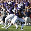 Photo - TCU running back B.J. Catalon (23) takes the handoff from quarterback Trevone Boykin (2) against Samford in the first half of an NCAA college football game in Fort Worth, Texas, Saturday, Aug. 30, 2014. Catalon scored on the play. (AP Photo/Jim Cowsert)