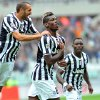Photo - Juventus midfielder Paul Pogba, center, of France celebrates with teammates Giorgio Chiellini, left, and Kwadwo Asamoah after scoring, during a Serie A soccer match between Torino and Juventus at the Olympic stadium, in Turin, Italy, Sunday, Sept. 29, 2013. (AP Photo/Massimo Pinca)