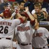 Photo - Arizona Diamondbacks' Miguel Montero is congratulated on his return to the dugout after a two-run home run against the San Diego Padres during the sixth inning of a baseball game Saturday, June 28, 2014, in San Diego. (AP Photo/Lenny Ignelzi)