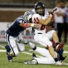 Photo - Yukon's Codey Sanchez tries to get past Edmond North's Scott Courtney during their high school football game at Wantland Stadium in Edmond, Okla., Thursday, October 4, 2012. Photo by Bryan Terry, The Oklahoman