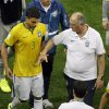 Photo - Brazil's coach Luiz Felipe Scolari, right, comforts Brazil's Thiago Silva as they leave the pitch with other players after the World Cup third-place soccer match between Brazil and the Netherlands at the Estadio Nacional in Brasilia, Brazil, Saturday, July 12, 2014. Robin van Persie and Daley Blind scored early goals to help give the Netherlands a 3-0 win over host Brazil in the third-place match at the World Cup on Saturday. (AP Photo/Themba Hadebe)