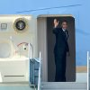 Photo -   President Barack Obama waves as he boards Air Force One at San Francisco International Airport, Tuesday, Oct. 9, 2012, in San Francisco, enroute to Ohio then onto Washington. (AP Photo/Noah Berger)
