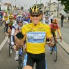 FILE - In this July 24, 2005, file photo, overall leader Lance Armstrong signals seven for his seventh straight win in the Tour de France cycling race as he pedals during the 21st and final stage of the race between Corbeil-Essonnes, south of Paris, and the French capital. Armstrong confessed to using performance-enhancing drugs to win the Tour de France during a taped interview with Oprah Winfrey that aired Thursday, Jan. 17, 2013, reversing more than a decade of denial. Armstrong called his run to seven Tour de France titles