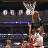 Photo - Chicago Bulls forward Taj Gibson (22) shoots over Atlanta Hawks' Jeff Teague, left, Elton Brand, center, and Gustavo Ayon during the first half of an NBA basketball game Tuesday, Feb. 11, 2014, in Chicago. (AP Photo/Charles Rex Arbogast)