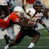 Oklahoma State\'s Perrish Cox (16) tries to take down Texas Tech Michael Crabtree (5) during the second half of the college football game between the Oklahoma State University Cowboys (OSU) and the Texas Tech University Red Raiders (TTU) at Boone Pickens Stadium on Saturday, Sept. 22, 2007, in Stillwater, Okla. By MATT STRASEN, The Oklahoman