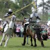 Sir Jacob (right) breaks his lance in a battle with Sir Maxwell during jousting at the Medieval Fair on Friday, March 30, 2012, in Norman, Okla. Photo by Steve Sisney, The Oklahoman