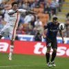 Photo -   Inter Milan forward Antonio Cassano heads the ball to score as Catania defender Pablo Sebastian Valeira Alvarez of Argentina jumps during a Serie A soccer match between Inter Milan and Catania, at the San Siro stadium in Milan, Italy, Sunday, Oct.21, 2012. (AP Photo/Luca Bruno)