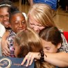 Students swarm around Jennifer Evans to give her hugs after the assembly. Highland Park fifth grade teacher Jennifer Evans was awarded $25,000 from the Milken Foundation during a school assembly Tuesday morning, Oct. 5, 2010. Evans did not know she was receiving the award and reacted with surprise and excitement when State Superintendent Sandy Garrett announced her name. Photo by Jim Beckel, The Oklahoman