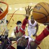 Photo - Houston Rockets' Dwight Howard, right, looks back to shoot as Milwaukee Bucks' Larry Sanders (8) defends during the first quarter of an NBA basketball game, Saturday, Jan. 18, 2014, in Houston. (AP Photo/David J. Phillip)