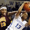 Photo - Kentucky's Bria Goss (13) pulls down a rebound under pressure from Central Michigan's Crystal Bradford (23) during the first half of an NCAA college basketball game, Sunday, Nov. 17, 2013, in Lexington, Ky. (AP Photo/James Crisp)