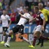 Photo - Manchester United's Angel Di Maria, center, keeps the ball from Burnley's Scott Arfield during their English Premier League soccer match at Turf Moor Stadium, Burnley, England, Saturday Aug. 30, 2014. (AP Photo/Jon Super)
