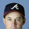 MAJOR LEAGUE BASEBALL: ** FILE ** This is a 2002 file photo of Greg Maddux of the Atlanta Braves. Maddux decided to stay with the Braves, accepting the team\'s offer of salary arbitration Thursday, Dec. 19, 2002. The four-time Cy Young Award winner had been a free agent. Accepting arbitration is the equivalent of signing a one-year deal for the 2003 season.(AP Photo/file)