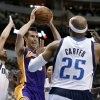 Photo - Los Angeles Lakers guard Steve Nash, center, goes up to pass from beneath the basket as Dallas Mavericks' Jose Calderon, left, of Spain, and Vince Carter (25) defend in the first half of an NBA basketball game, Tuesday, Nov. 5, 2013, in Dallas. (AP Photo/Tony Gutierrez)