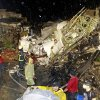 Photo - Rescue workers work next to the wreckage of TransAsia Airways flight GE222 which crashed while attempting to land in stormy weather on the Taiwanese island of Penghu, late Wednesday, July 23, 2014. A plane landing in stormy weather crashed outside an airport on a small Taiwanese island late Wednesday, and a transport minister said dozens of people were trapped and feared dead. (AP Photo/Wong Yao-wen)