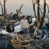Residents begin digging through the rubble of their home after it was destroyed by a tornado that hit Joplin, Mo. on Sunday evening, May 22, 2011. The tornado tore a path a mile wide and four miles long destroying homes and businesses. (AP Photo/Mike Gullett) ORG XMIT: MOMG109