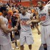 From left, OSU\'s Brian Williams (4), Markel Brown (22) and Michael Cobbins (20) stop to shake hands with each other before leaving the floor after the Bedlam men\'s college basketball game between the Oklahoma State University Cowboys and the University of Oklahoma Sooners at Gallagher-Iba Arena in Stillwater, Okla., Monday, Jan. 9, 2012. OSU beat OU, 72-65. Photo by Nate Billings, The Oklahoman