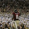 Florida State\'s Timmy Jernigan celebrates with fans after the NCAA BCS National Championship college football game against Auburn Monday, Jan. 6, 2014, in Pasadena, Calif. Florida State won 34-31. (AP Photo/Chris Carlson)