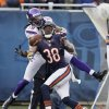 Photo -   Chicago Bears defensive back Zack Bowman (38) breaks up a pass intended for Minnesota Vikings wide receiver Devin Aromashodu (19) in the second half of an NFL football game in Chicago, Sunday, Nov. 25, 2012. The Bears won 28-10. (AP Photo/Charles Rex Arbogast)