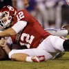 Joseph Bonugli (25) and quarterback Landry Jones (12) fight for a ball initially called a fumble that was later reversed to an attempted forward pass during the second half of a college football game where the University of Oklahoma Sooners (OU) lost 24-19 to the Kansas State University Wildcats (KSU) at Gaylord Family-Oklahoma Memorial Stadium, Saturday, September 22, 2012. Photo by Steve Sisney, The Oklahoman