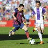 Photo - Barcelona's Lionel Messi from Argentina, left, and Valladolid's defender Jesus Rueda challenge for the ball during a Spanish La Liga soccer match at the Jose Zorrilla stadium in Valladolid, Spain, Saturday March 8, 2014. (AP Photo/Israel L. Murillo)