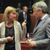 Photo - Italy's Foreign Minister Federica Mogherini, left, talks with Belgium's Foreign Minister Didier Reynders during an EU foreign ministers meeting at the European Council building in Brussels Monday, May 12, 2014. EU foreign ministers discuss the situation in Ukraine. (AP Photo/Yves Logghe)
