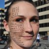 Lacey Brown placed 176 eyeliner dots on her face one for every injured person and three dots on the other side for the fatalities of the Boston Marathon explosions to carry them with her during the weekly McGinley\'s Pub Run in Anchorage on Tuesday, April 16, 2013. About 350 people took part in the 3-mile run that began with a moment of silence near the start at Skinny Raven Sports. (AP Photo/Anchorage Daily News, Bill Roth)