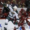 Photo - Phoenix Coyotes' Oliver Ekman-Larsson (23), of Sweden, checks Minnesota Wild's Charlie Coyle (3) during the first period of an NHL hockey game, Saturday, March 29, 2014, in Glendale, Ariz. (AP Photo/Ross D. Franklin)