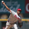 Photo - Philadelphia Phillies starting pitcher Roberto Hernandez works against the Colorado Rockies in the first inning of a baseball game in Denver, Sunday, April 20, 2014. (AP Photo/David Zalubowski)